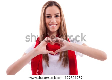 Smiling beautiful girl shows heart with hands
