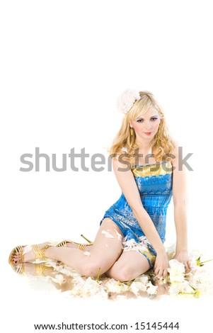 smiling beautiful girl sitting among peony - stock photo