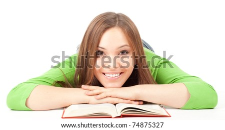 smiling beautiful girl with book lying on the floor, series - stock photo