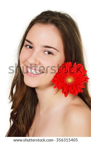Smiling beautiful girl with flower on white  - stock photo