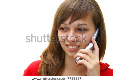 Smiling beautiful teen girl talking on cell phone on white background