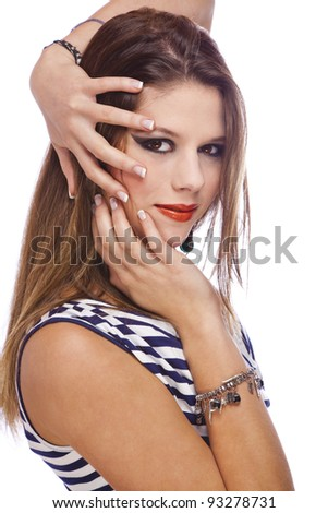 smiling beautiful teenage model showing her acrylic nails, photographed on white studio background