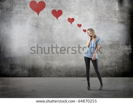Smiling beautiful woman in love talking to telephone - stock photo