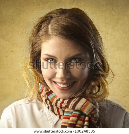 Smiling beautiful woman in warm clothes - stock photo