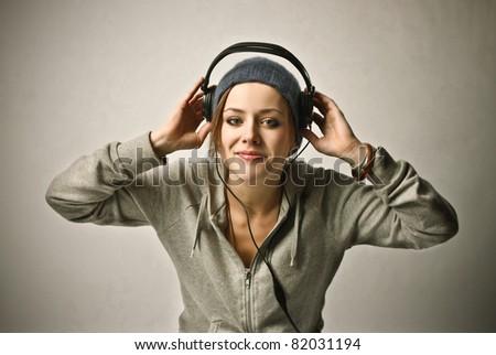 Smiling beautiful woman listening to music - stock photo