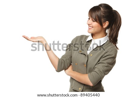 Smiling beautiful woman looking at blank copy space on her palm - empty space for product or text, isolated on white background - stock photo