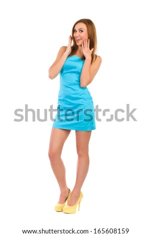 Smiling beautiful woman looking surprised. Full length studio shot isolated on white. - stock photo