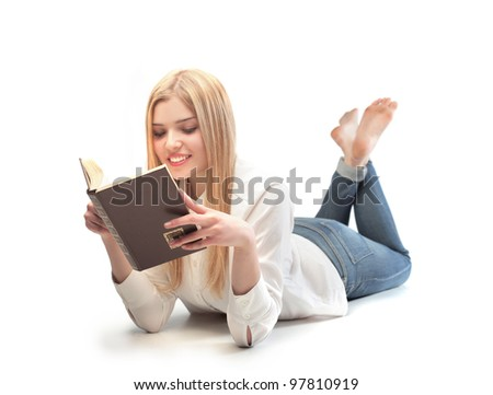 Smiling beautiful woman reading a book - stock photo