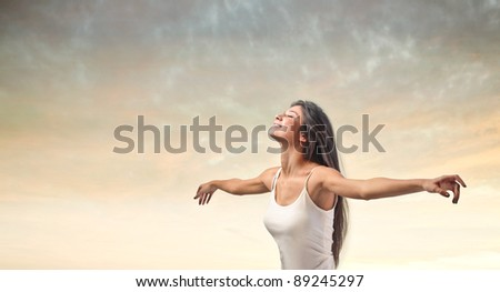Smiling beautiful woman stretching out her arms