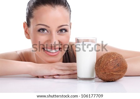 Smiling beautiful woman with coconut milk - stock photo
