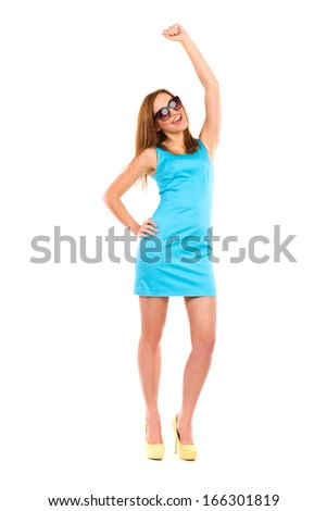 Smiling beautiful woman with raised hand. Full length studio shot isolated on white. - stock photo