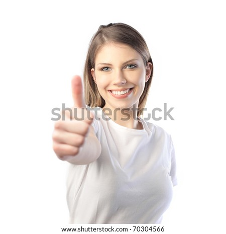 Smiling beautiful woman with thumbs up
