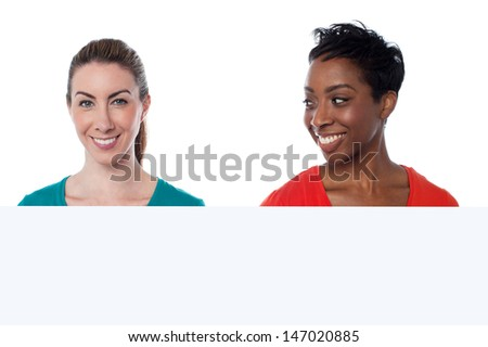 Smiling beautiful women posing together