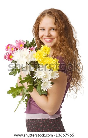 smiling beautiful young girl with spring flowers - stock photo