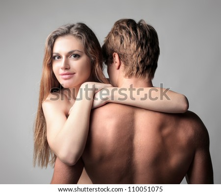 Smiling beautiful young woman embraced to her boyfriend - stock photo