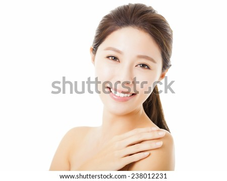 smiling beautiful young  woman face isolated on white - stock photo