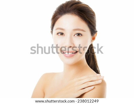smiling beautiful young  woman face isolated on white