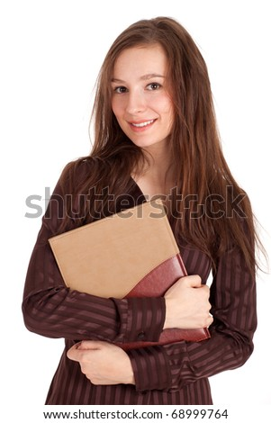 smiling beautiful young woman in brown bouse with book