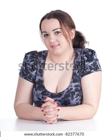 smiling beautiful young woman in dark dress - stock photo