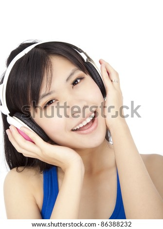 smiling beautiful  young woman  listening to music - stock photo