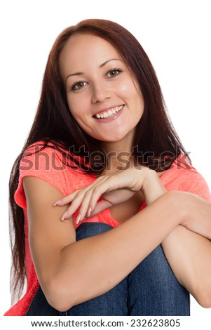 Smiling beautiful young woman sitting on the floor. Girl of twenty-seven years.