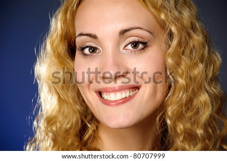 smiling beautiful young woman with blond hair and Looking At Camera for shooting in the studio