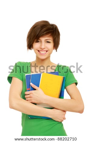 smiling beautiful young woman with book isolated on white background - stock photo