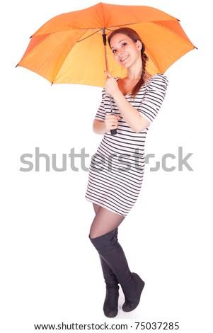 smiling beautiful young woman with orange umbrella - stock photo