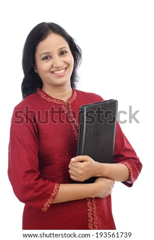 Smiling beautiful young woman with tablet computer against white background - stock photo