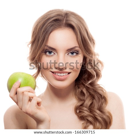 Smiling beauty holding green apple while isolated on white - stock photo