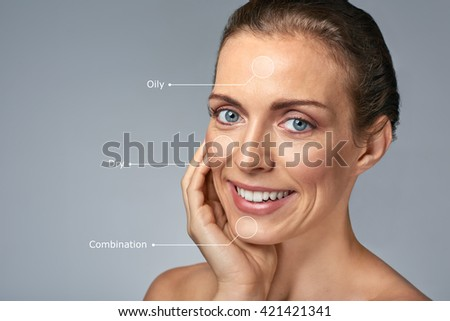 Smiling beauty portrait of elegant middle age caucasian woman, isolated in studio - stock photo