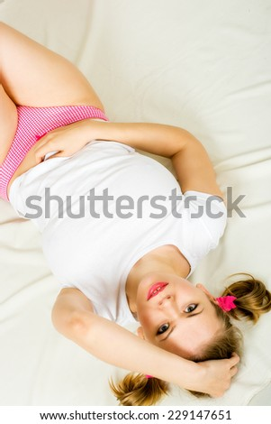 Smiling Beauty woman On A Bed in pin-up style - stock photo