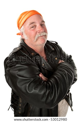 Smiling biker gang member with leather jacket - stock photo