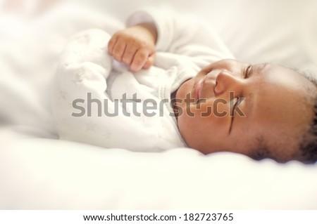 Smiling black african newborn baby - stock photo