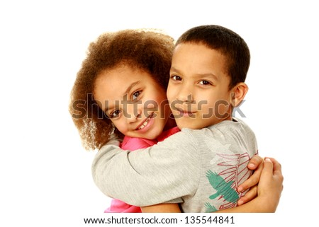 smiling black children hugging with copy space