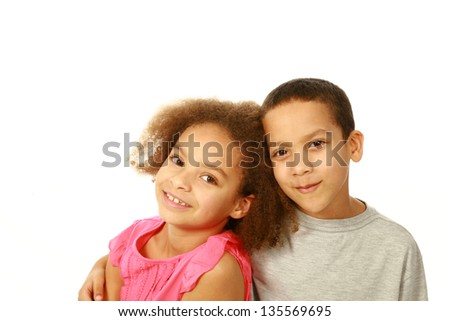smiling black children hugging with copy space - stock photo