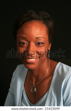 Smiling black woman looking at the camera - stock photo