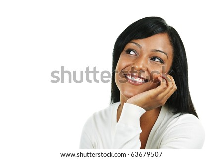 Smiling black woman looking up isolated on white background - stock photo