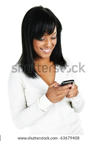 Smiling black woman texting on cell phone portrait isolated on white background - stock photo