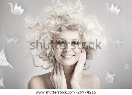 Smiling blond beauty - stock photo