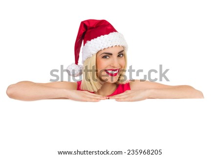 Smiling blond christmas girl lean on a white banner. Studio portrait isolated on white. - stock photo
