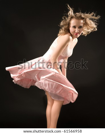 Smiling blond girl with fluttering dress