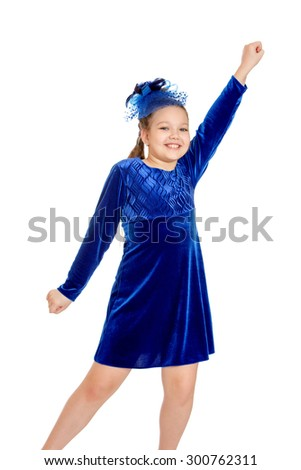 Smiling blond girl with pigtails on her head in a hat with netting and a long blue velvet dress. Girl Otrokovice waving his hands , close-up - stock photo