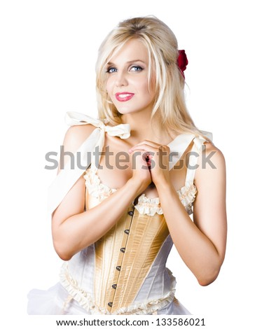 Smiling blond pinup woman wearing lacy  sexy corselet dress tied with bows on white background