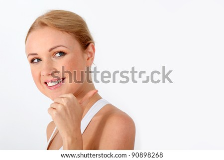 Smiling blond woman showing thumb up on white background