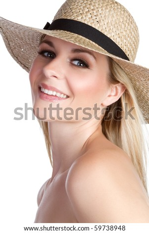 Smiling blond woman wearing hat