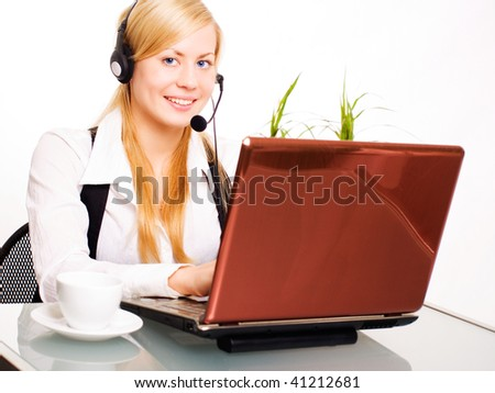 smiling blond woman working with computer in office
