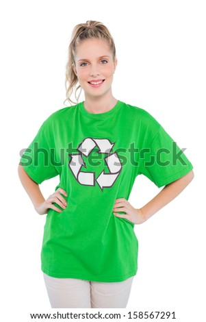 Smiling blonde activist wearing recycling tshirt posing on white background - stock photo