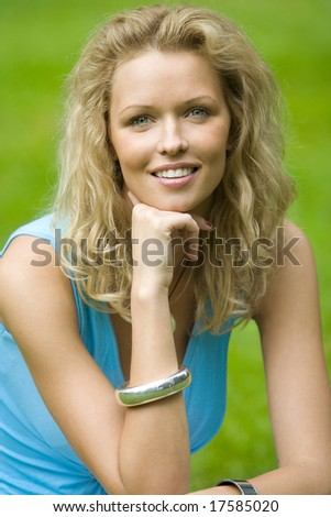 smiling blonde beautiful woman in the park - stock photo