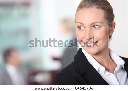 Smiling blonde businesswoman - stock photo